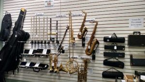 Various brass instruments on wall