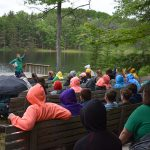 Campers listening to speaker