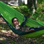 Boy making funny face in hammock