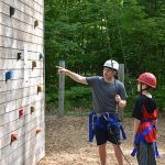 Instrutor telling kid how to rock climb