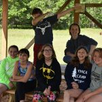 Camp group photo at picnic table